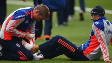 Mark Wood receives treatment on his foot