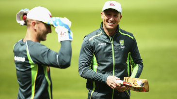 Brad Haddin helps Peter Nevill with his wicketkeeping drills