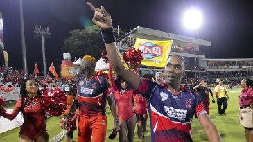 Trinidad & Tobago Red Steel captain Dwayne Bravo does a victory lap