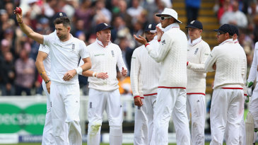 James Anderson celebrates his five-wicket haul after removing Mitchell Johnson for 3