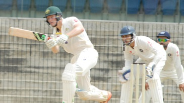 Cameron Bancroft drives the ball through the leg side