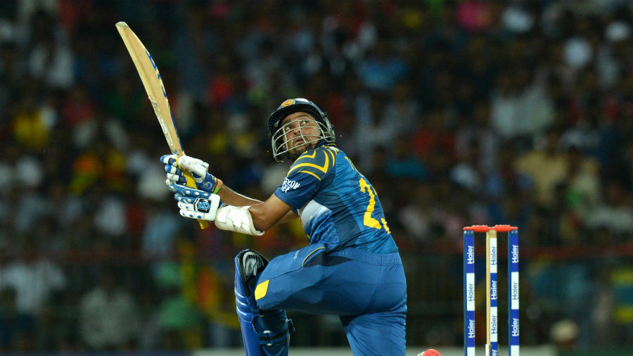 Tillakaratne Dilshan hoists it over the wicketkeeper