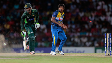 Shoaib Malik makes it back to his crease in time to avoid a run-out