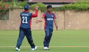 Sompal Kami gets congratulated after taking the wicket of Preston Mommsen, Scotland v Nepal, ICC World Cricket League Championship, Ayr, July 29, 2015