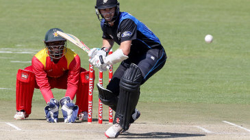 Kane Williamson skips down the track