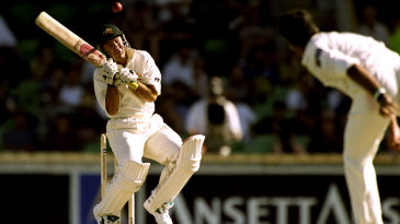 Ricky Ponting avoids a bouncer