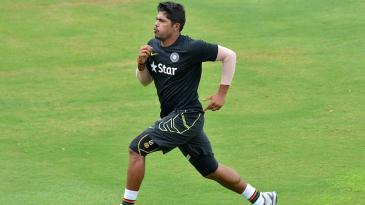 Umesh Yadav runs hard during a training session
