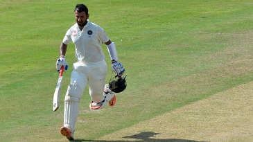 Cheteshwar Pujara runs between the wickets