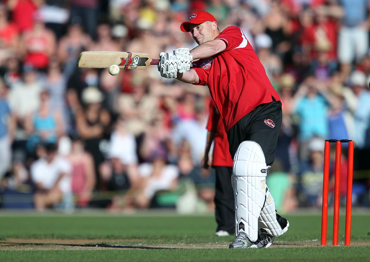 New Zealand prime minister John Key bats