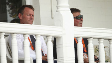 Pat Howard and Rod Marsh watch the collapse unfold