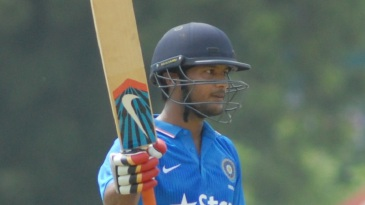 Mayank Agarwal raises his bat after reaching a century