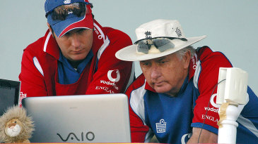 Michael Vaughan and Duncan Fletcher are busy on the laptop
