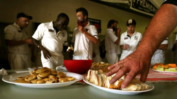 Cricketers socialise in the tea break as pies and sandwiches get served during a 1st grade match between Crib Point v Rye at Crib Point Recreational Reserve