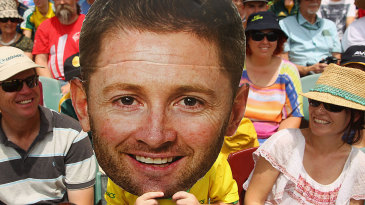 The Mask: a fan holds a giant cutout of Michael Clarke's face