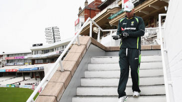 Michael Clarke walks onto The Oval outfield