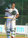 Omphile Ramela gets a hug from Temba Bavuma after completing his ton, India A v South Africa A, 1st Unofficial Test, Wayanad, August 18, 2015