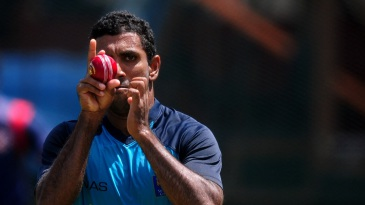Target locked: Dhammika Prasad runs in to bowl at training