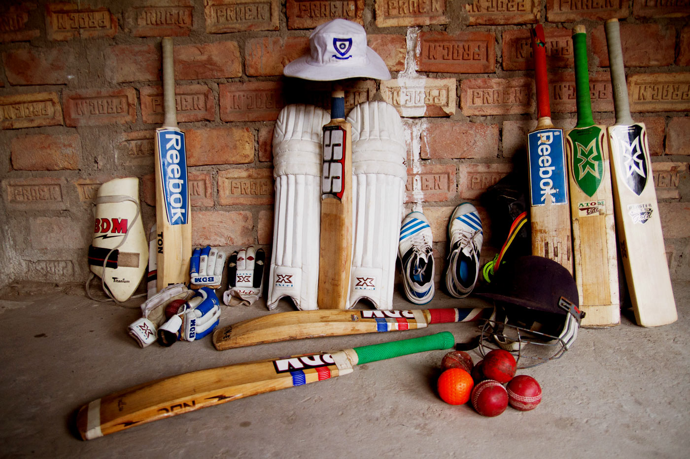 Ankit's cricket equipment lined up against the wall in a room that was being constructed on the first floor of his parents' house for him