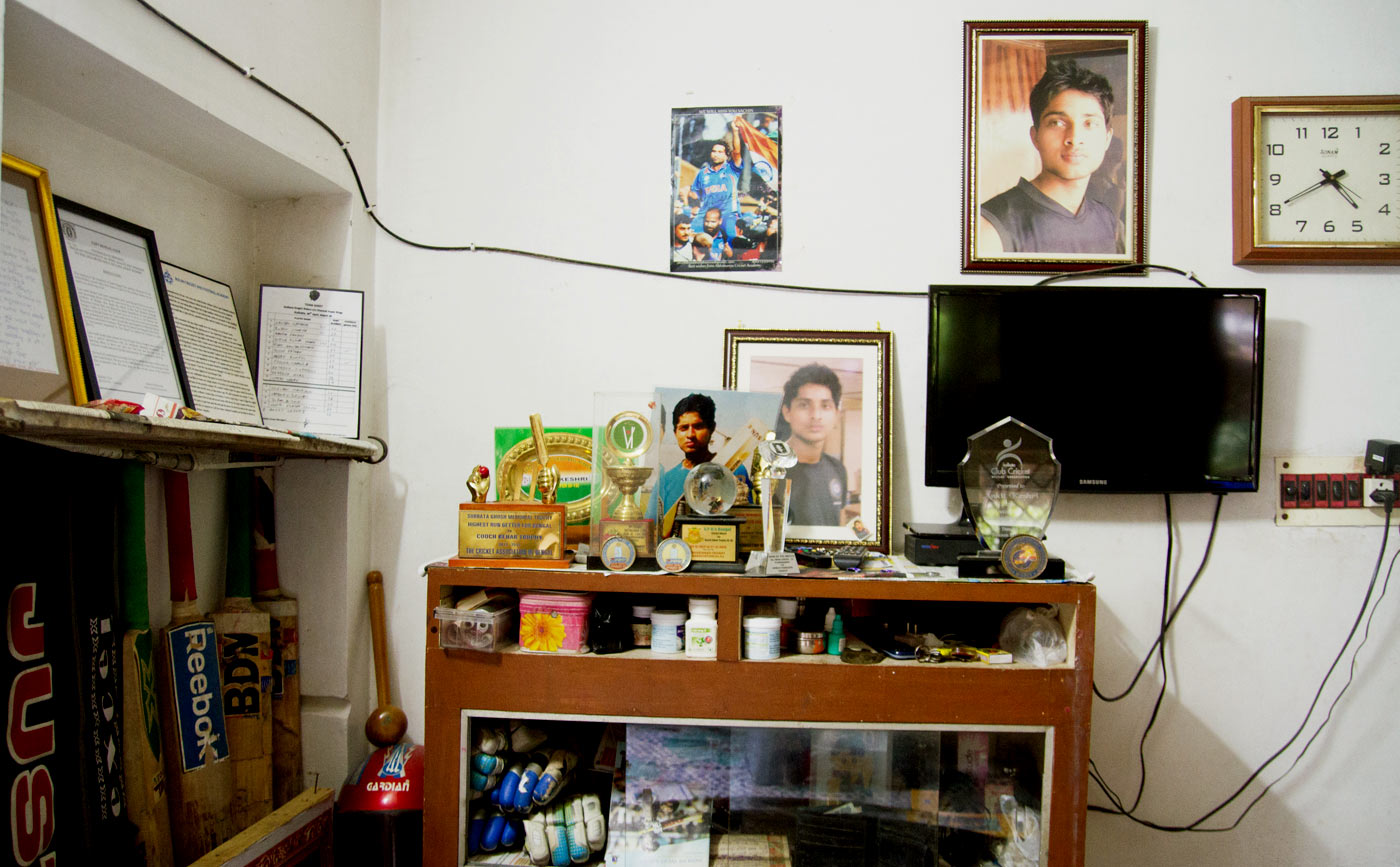 Ankit's trophies and cricket equipment populate a part of his parents' house that has now turned into a shrine for him