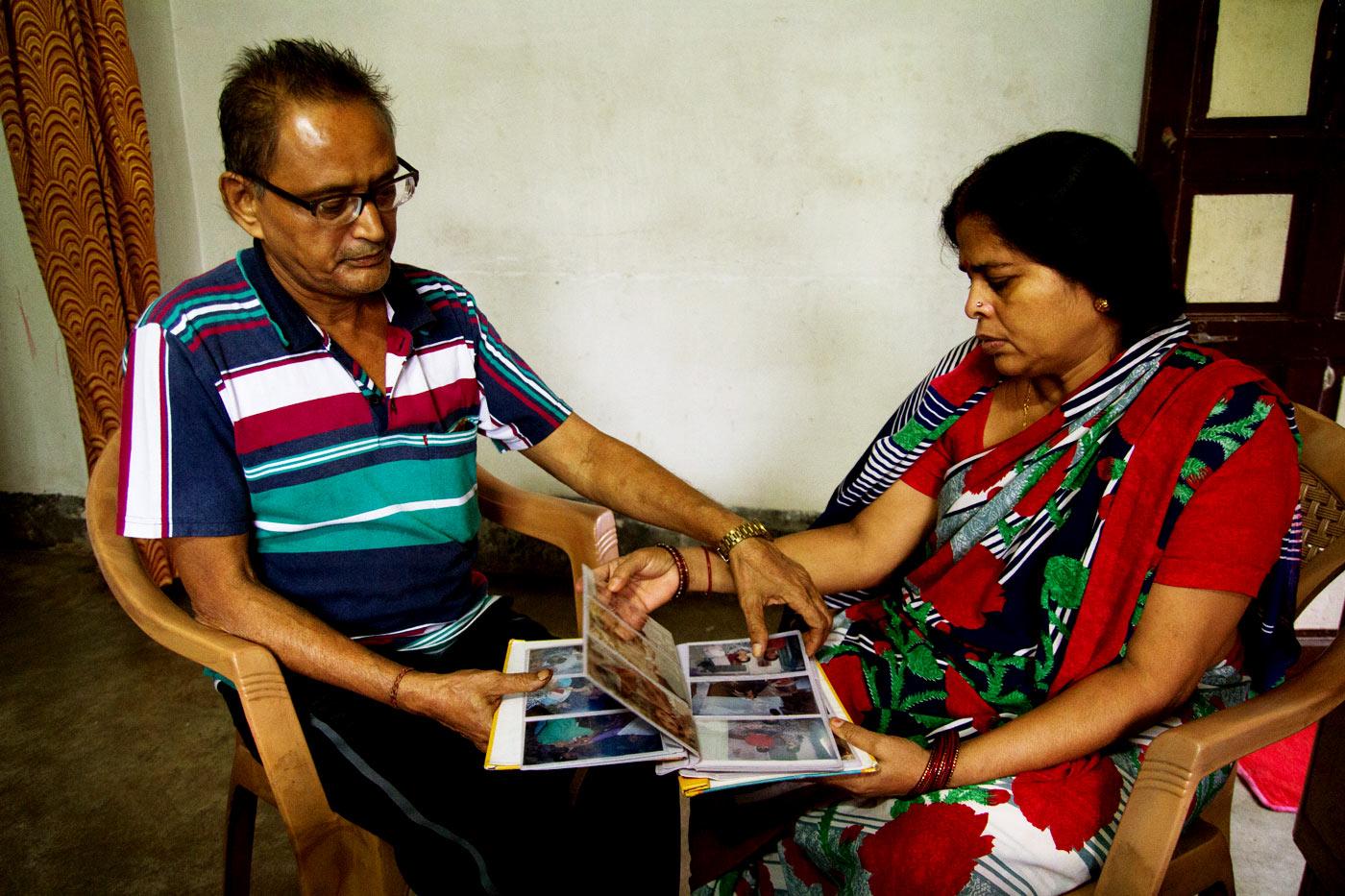 Raj Kumar and Nirmala Keshri look at childhood photographs of their son