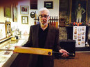 Dave Roberts poses with an bat of Don Bradman's, Haverford, Pennsylvania, 2015
