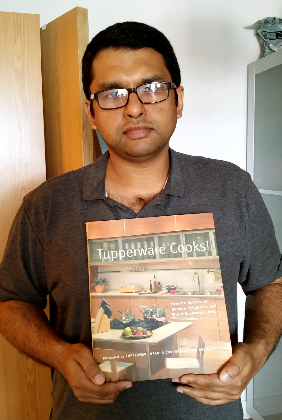 The writer poses with the very book with which he won the 2013 All Kerala Under-17 Book Cricket League