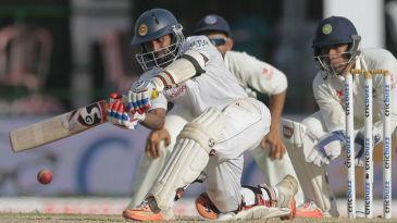 Kaushal Silva gets down to sweep