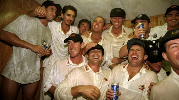 Australia celebrate their innings victory with a beer or 20