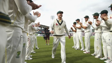 Michael Clarke walks through a guard of honour