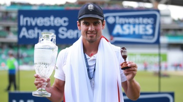 Alastair Cook poses with the Ashes Urn and trophy