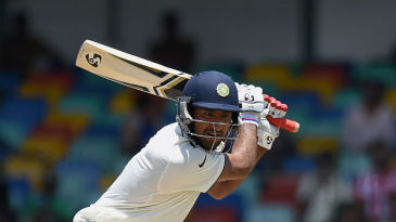 Cheteshwar Pujara strokes one through the off side