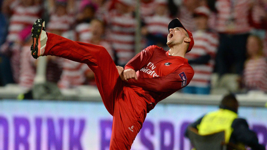 Liam Livingstone celebrates taking a catch in the deep to dismiss Shahid Afridi