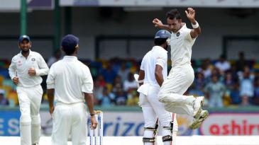 Stuart Binny breaks into his trademark celebration after a wicket