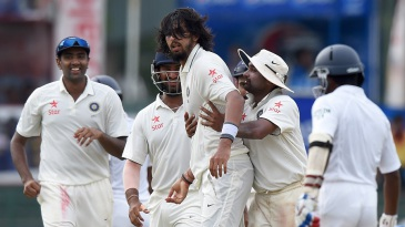 Ishant Sharma is mobbed by his team-mates