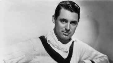 Cary Grant poses in a cricket sweater
