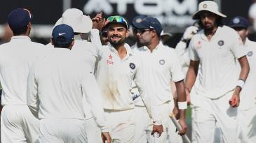 Virat Kohli takes high-fives after the win