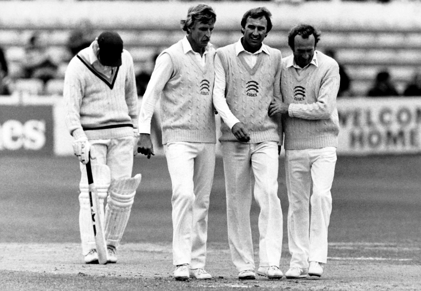 Stuart Turner, John Lever and Keith Fletcher walk back after a county match in Chelmsford, 1983