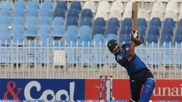 Shahzaib Hasan drills the ball through the off side