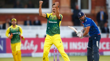 Mitchell Starc celebrates after taking the wicket of Liam Plunkett