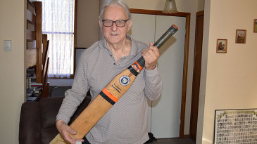 John Guy poses with the Excalibur bat used by Lance Cairns