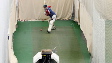 Andrew Flintoff faces a bowling machine in the indoor nets