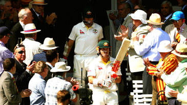 David Warner and Chris Rogers walk out to bat