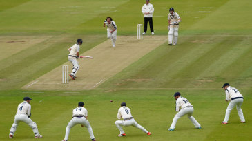 Adam Lyth stoops to take a catch off Ryan Sidebottom's bowling