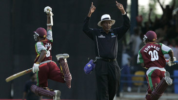Shivnarine Chanderpaul leaps in celebration after his match-winning six