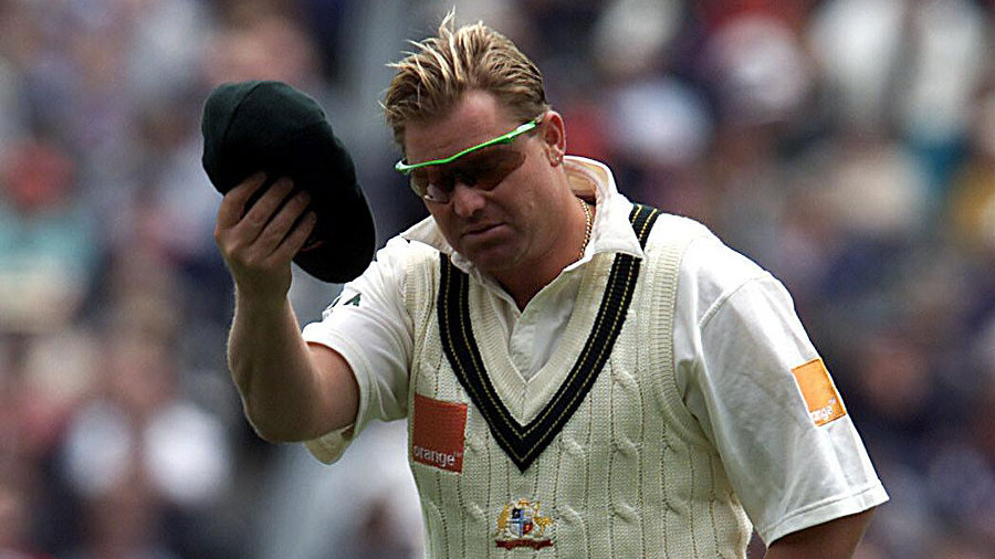 Shane Warne takes his hat off