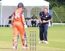 Josh Davey fields in his follow through to keep Wesley Barresi in his crease, Netherlands v Scotland, WCL Championship, Amstelveen, September 14, 2015