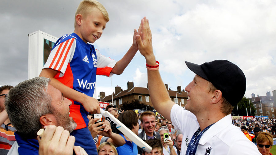 Joe Root high-fives a young England supporter