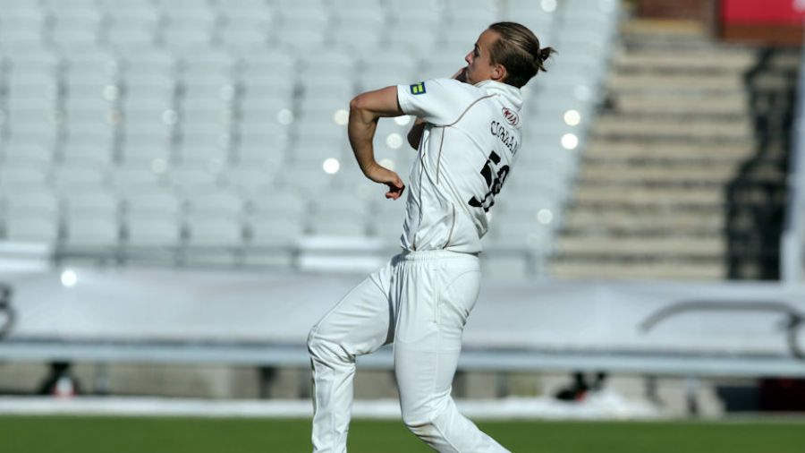 Tom Curran bowls for Surrey against Lancashire