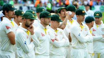 Australian players watch England's celebrations