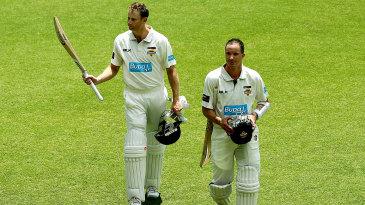 Adam Voges and Michael Klinger walk back after their win over Tasmania